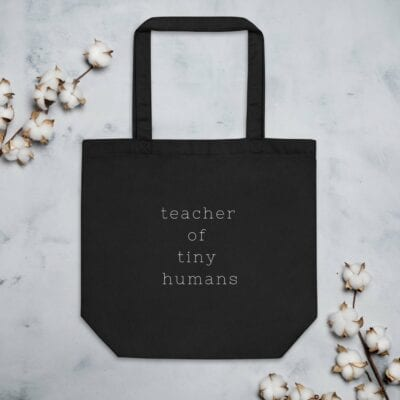 Teacher of tiny humans tote bag in black