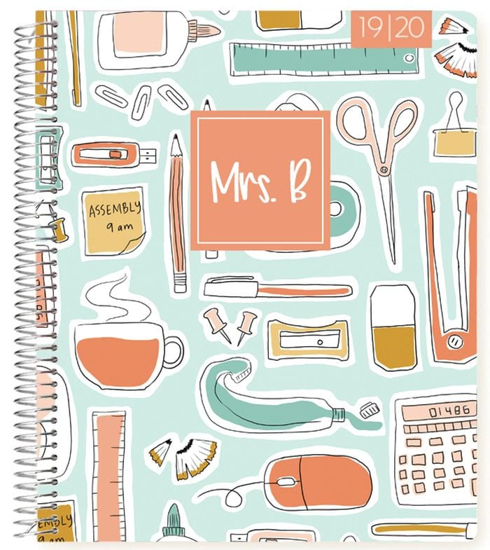 Spiral-bound planner with school supplies on cover