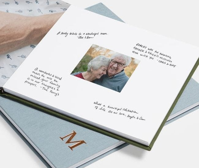 Photo book showing an older couple surrounded by hand-written messages (Teacher Retirement Gifts)
