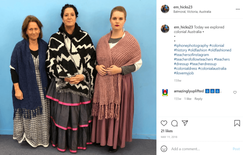 Three teachers in front of a blue wall dressed as colonial Australians