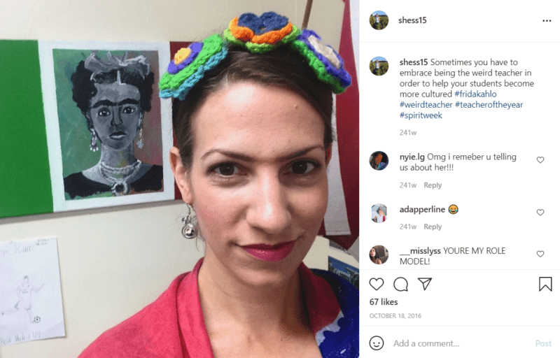Closeup of the face of a teacher dressed as Frida Kahlo while standing in front of a rendering of Frida Kahlo's famous self portrait