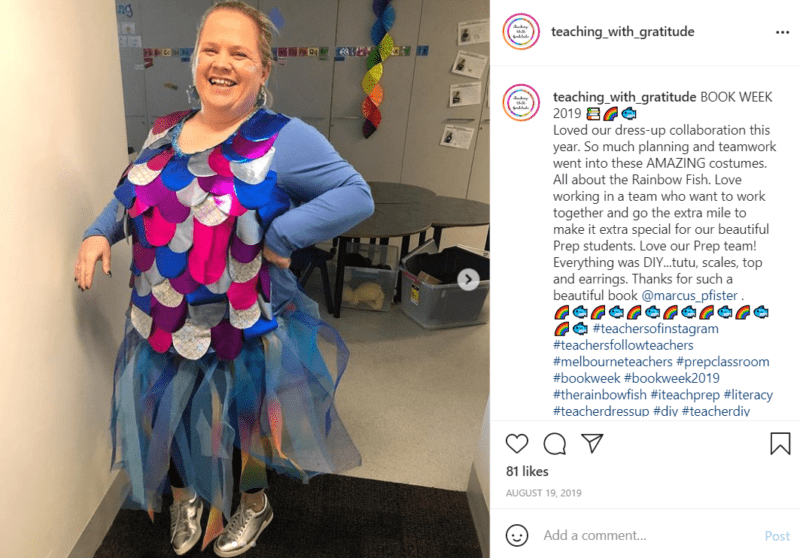 Teacher dressed as a rainbow fish with silver shoes in classroom