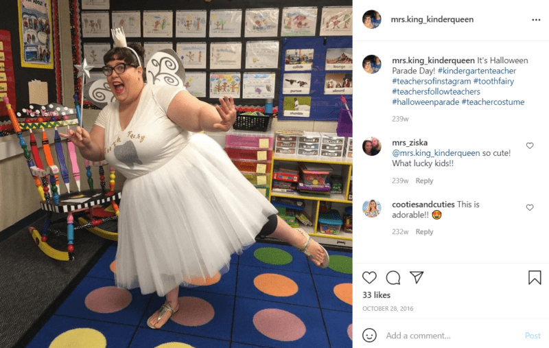 Teacher in a classroom with polka dot carpet dressed as the tooth fairy