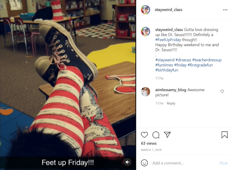 Teacher wearing red and white striped socks, one featuring the cat in the hat to celebrate the birthday of Dr. Seuss