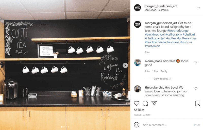 Chalkboard wall along a coffee counter with coffee maker and mugs