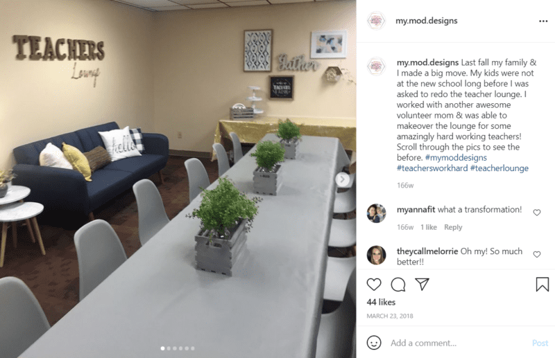 Long grey table with seating around it and a blue couch with a Teachers Lounge sign above it