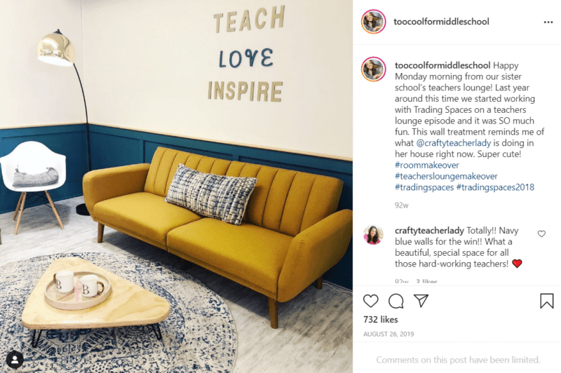 """Teachers lounge with a mustard yellow couch and blue wall paint and a sign that says """"Teach Love Inspire"""""""