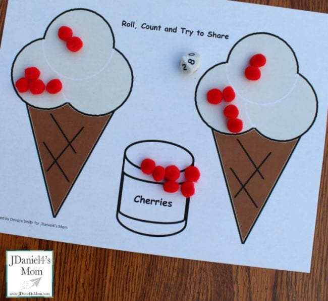 Printed worksheet with two ice cream cones and pile of red poms poms representing cherries
