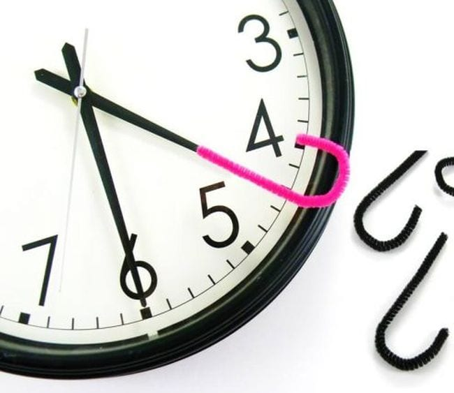 Analog clock with a pink pipe cleaner hook attached to the hour hand (Telling Time)