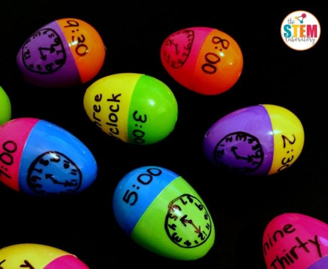 Plastic Easter eggs with analog clocks written on one half and digital and word times written on the other halves