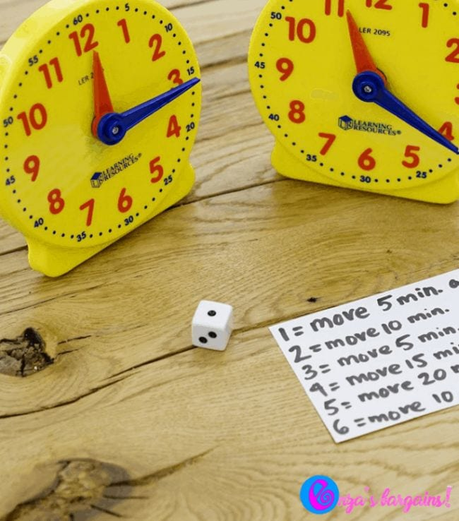 Two toy clocks and a notecard with the rules for the Rush Hour game (Telling Time)