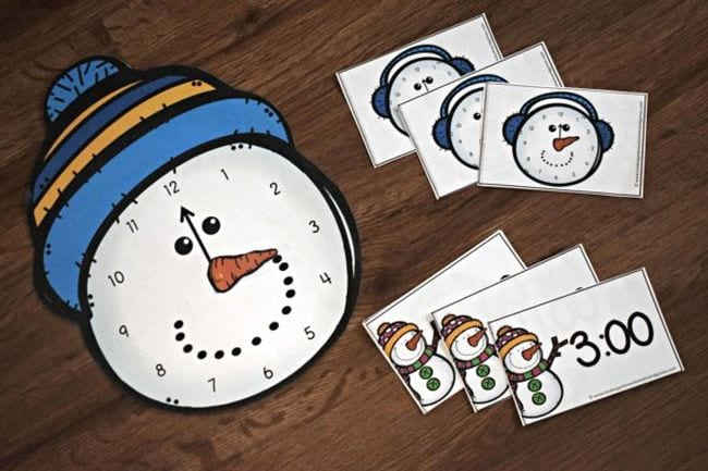 Snowman heads with clocks on them, with time cards (Telling Time)