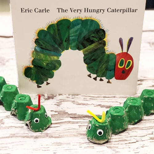 Egg carton caterpillars in front of The Very Hungry Caterpillar book