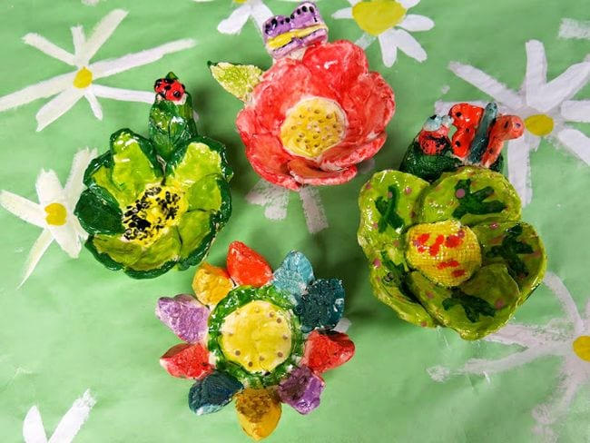 Simple ceramic flower bowls with bugs and butterflies (Third Grade Art Projects)
