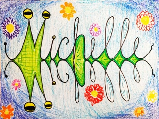 The name Michelle written in cursive with a reflected version below, colored to look like a bug (Third Grade Art Projects)
