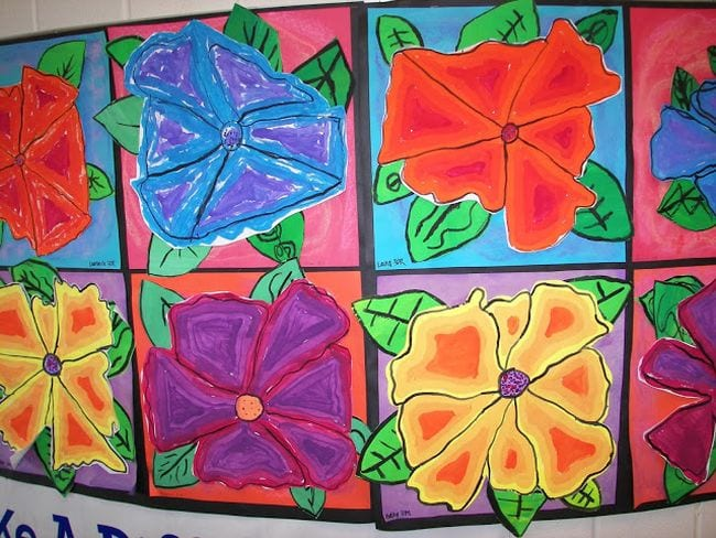 Large red, blue, yellow, and purple flowers in the style of Georgia O'Keeffe (Third Grade Art)