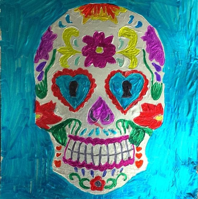 Colorful Mexican sugar skull imprinted on aluminum foil (Third Grade Art Projects)