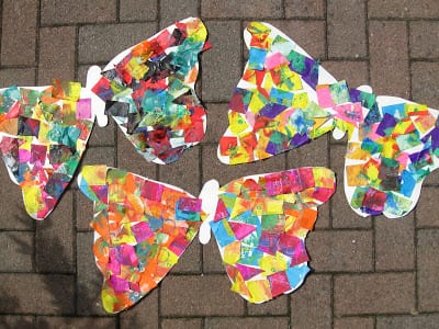 Colorful butterflies made from construction paper and cut squares of tissue paper