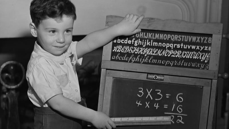 Black and white photograph student doing times tables - 30 Things Today's Students Will Never Understand