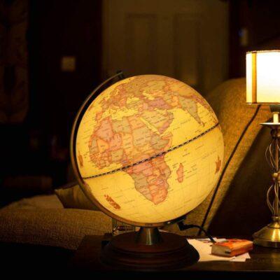 TTKTK Illuminated Antique Globe shown lit up on a living room side table