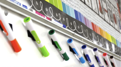 Velcro dry erase markers to the white board