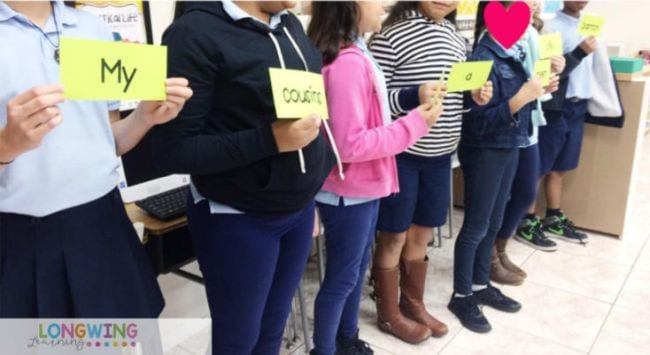 Kids lined up holding word cards to form a sentence