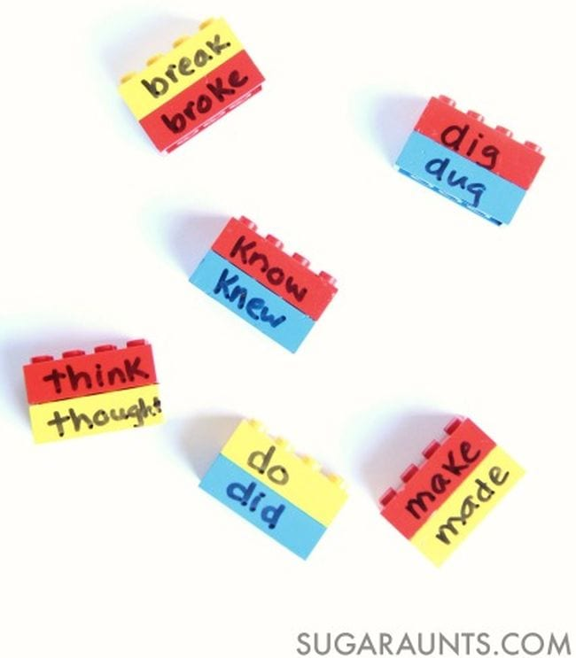 Lego bricks labeled with present and past tense of irregular verbs