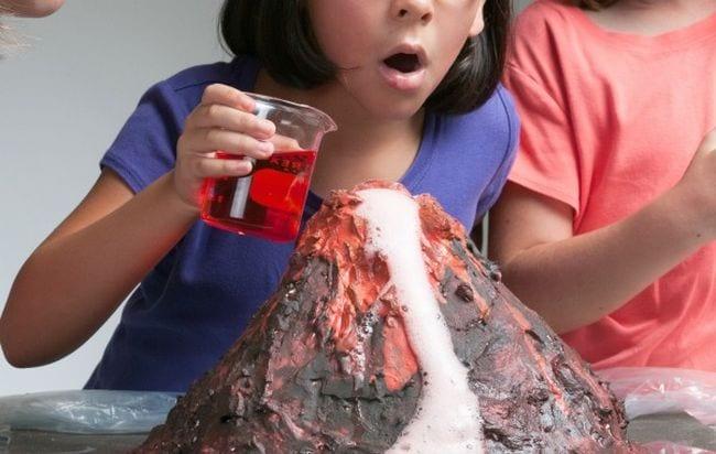 Students watch a model volcano erupt (Volcano Science Experiments)