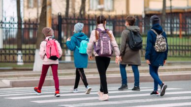 School children cross the road for a walking school bus.