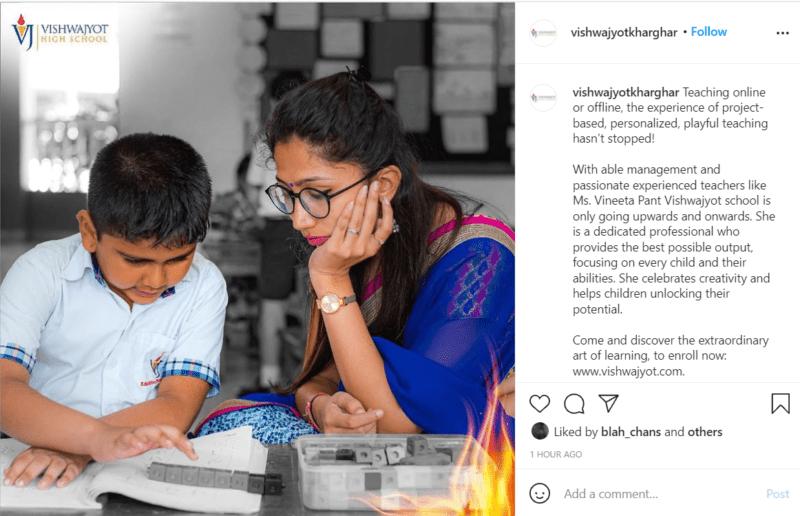Teacher sitting at a desk with student using base ten math blocks