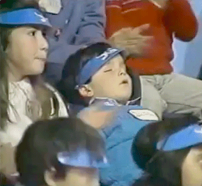 Child asleep at sporting event