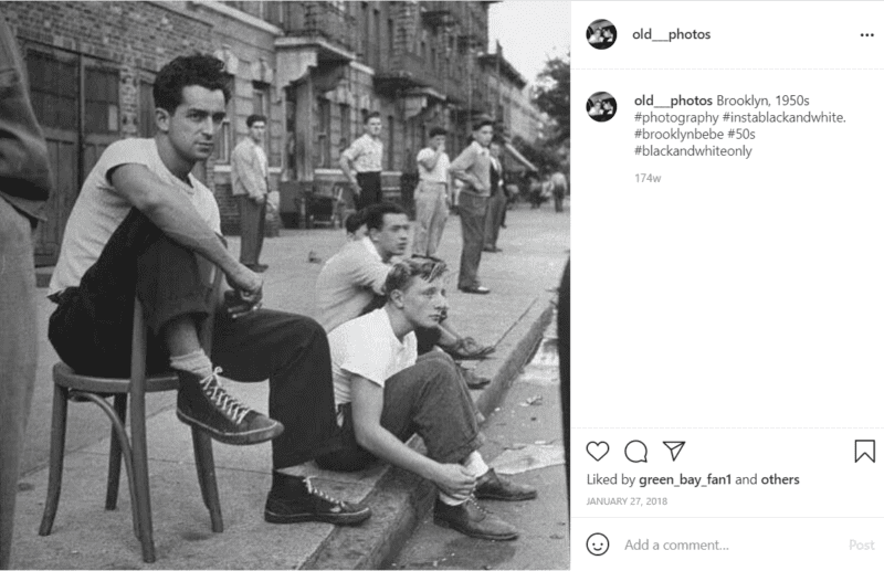 Black and white photo of people on the sidewalk
